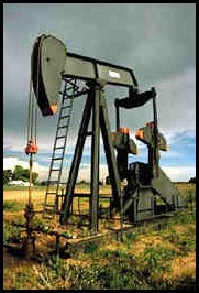 Photo of an oil drill in a field.