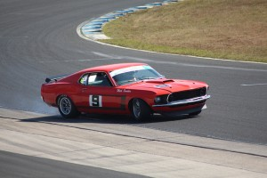Photo of a vintage red camaro racing